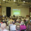 packed_meeting_against_mayfields